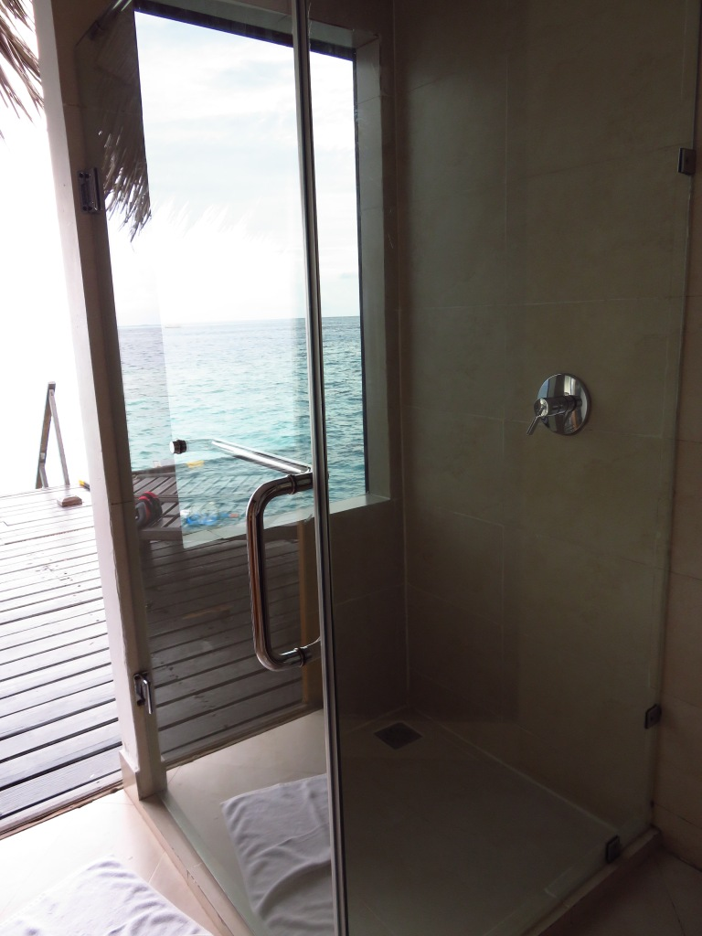 Maldives glass shower in water bungalow