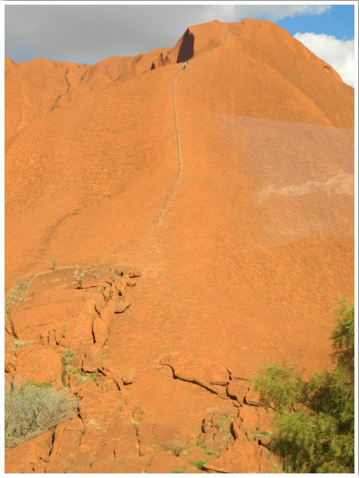 Climbing Uluru.  The climb to the top of Ayers Rock closed in 2019