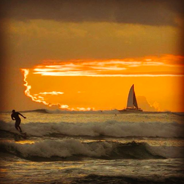 Sunset and surfing Hawaii