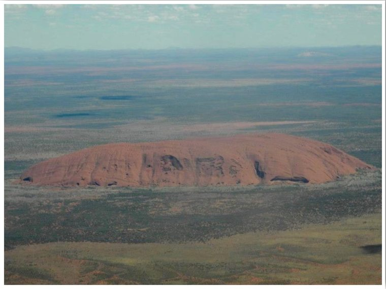Uluru from above. Ayers Rock airport to Sydney Australia flight