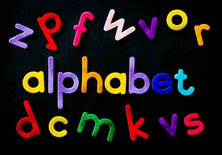 assorted color alphabet on black background: Photo by Magda Ehlers